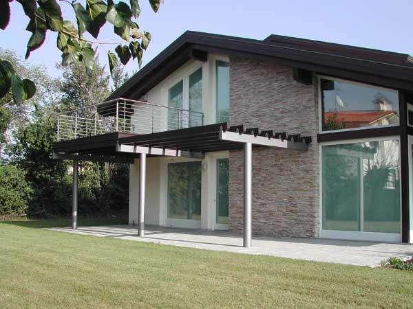 Ville in legno di lusso wood beton prestige una linea di for Piani casa di lusso 2015
